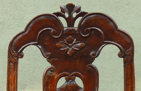 A pair of late 17th century walnut chairs